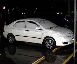 Snow on a car at Ballan road-stop
